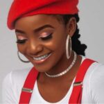 Simi Reacts To A Fan Who Said She Should Be In Heaven Singing To God